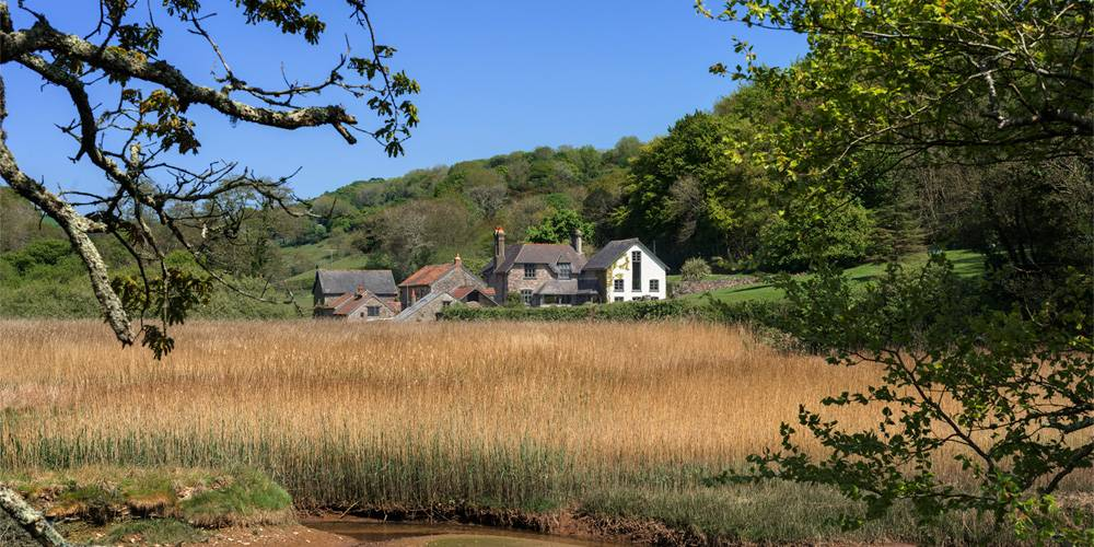 Devon Architects Estuary view of mill house and barns