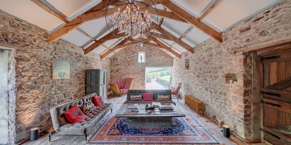 Devon Architects Main barn lounge with shutters open Soho House