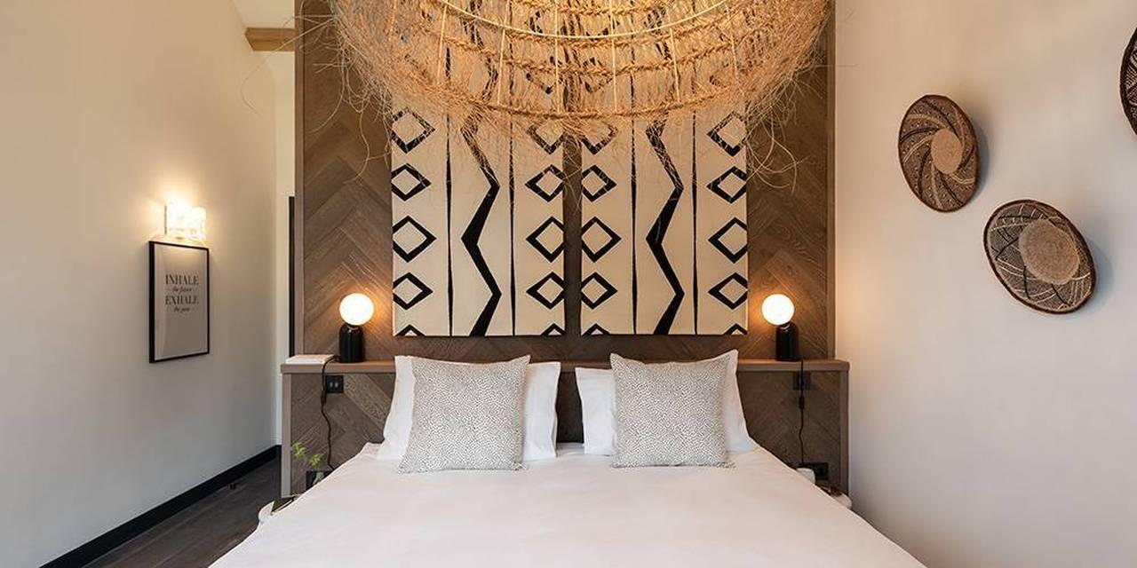 Devon architects bedroom herringbone headboard wall