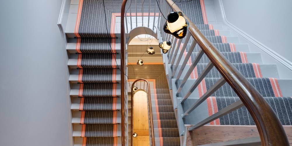 Architects Devon stairwell lighting and Roger Oates stair runner