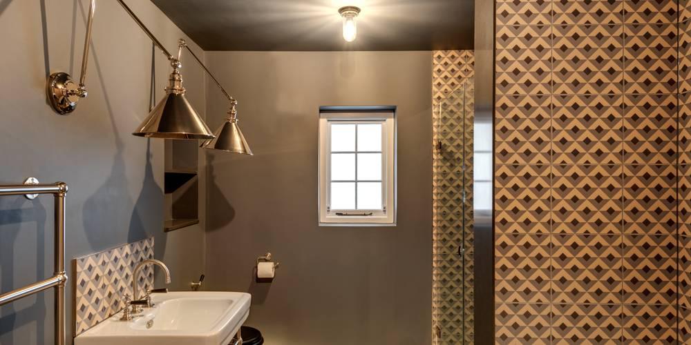Guest bathroom encaustic tiling and lighting