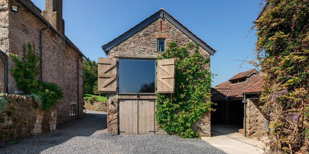 Devon Architects Main barn with shutters open