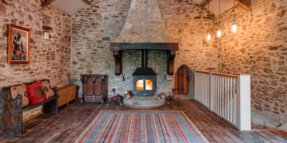 Devon Architects Main barn fireplace Soho House