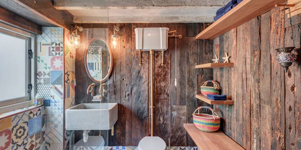 Devon Architects Utility shower room with copper taps and encaustic tiles Soho House